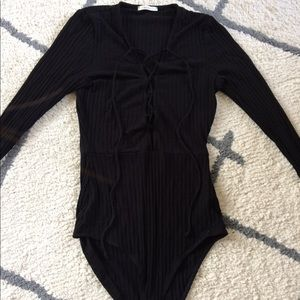 Lace up front black bodysuit in size small